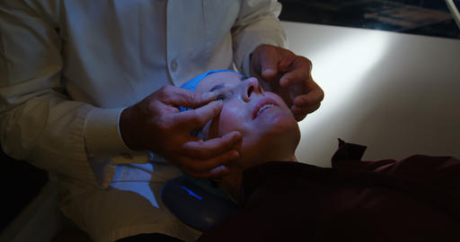 Optometrist examining patient eyes in clinic 4k Live Action