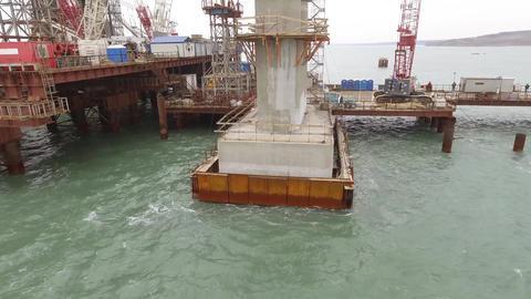 Construction of the bridge. Engineering facilities for the construction of a Live Action