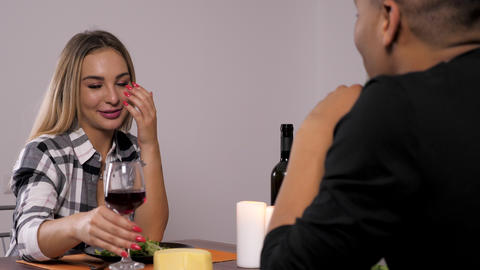 Interracial couple clink their glasses at the dinner Footage