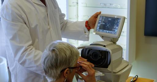 Optometrist explaining eyesight report on autorefractors screen 4k Live Action