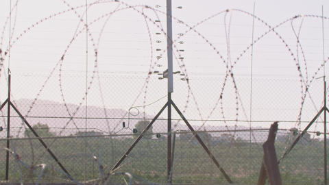Border fence between Israel and West Bank. barbed wire electronic fence Live Action