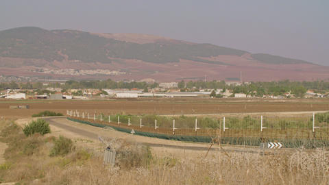 Border fence between Israel and West Bank. barbed wire electronic fence GIF