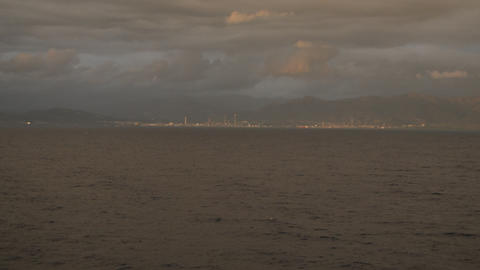 View from the cruise ship to the rocky shore, ships, clouds at dusk, the ship Live Action
