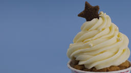 Cupcake muffin with whipping cream for celebrate Christmas. set on light blue Footage