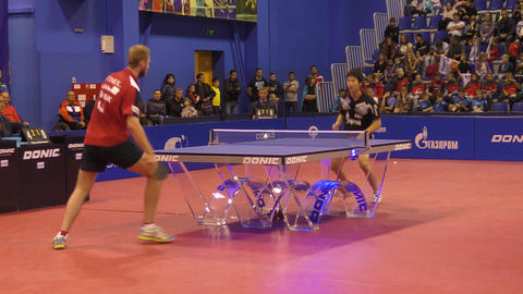 Orenburg, Russia - September 28, 2017 year: boy compete in the game table tennis GIF