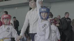 The referee raises the winner's arm-the child in children's Taekwondo Footage