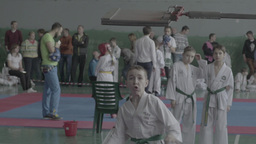 Kids do Tae Kwan do in the gym. Children's sports. Slow motion Footage