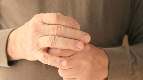 Older man struggles with pill container Footage