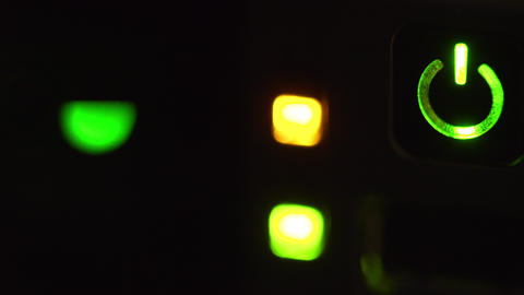 macro of server lights blinking in a dim server room focus on power button 4k Footage