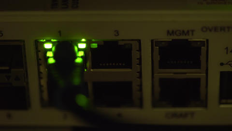 ethernet switch traffic light blinking in a dimly lit server room 4k Footage