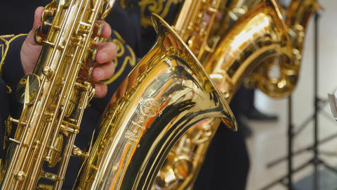 Musician playing the saxophone, closeup Footage