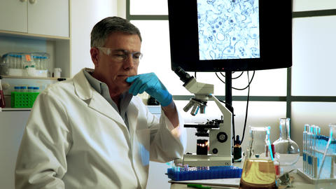 virologist in thought about the cure for zika virus Footage
