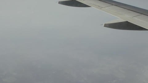 The wing of the aircraft in high altitude Live Action