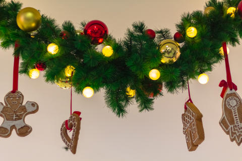 Christmas tree with decorative balls and glittering lights フォト