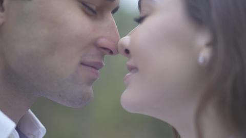Closeup of a young couple kiss Male and female rub their noses and kiss Guy with Live Action