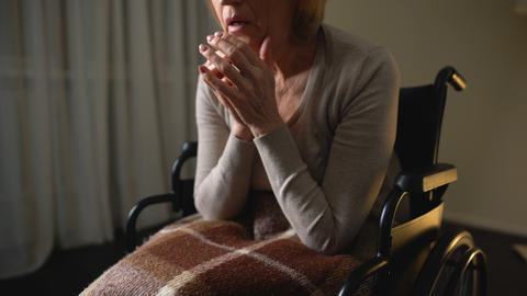 Sick woman wheelchair feeling lonely and depressed, hopelessness in nursing home Footage