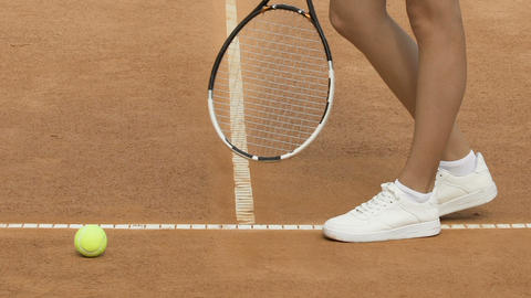 Sportive slim girl preparing before tennis game, outdoor trainings, close up Live Action