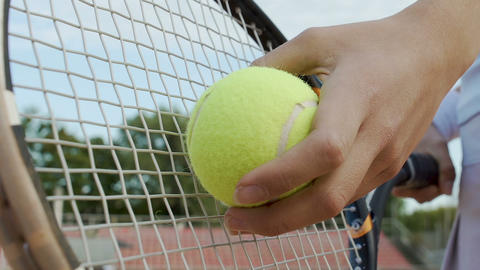 Successful self-confident woman serves tennis ball, desire to win, bottom view Live Action