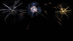 Brightly colorful fireworks for events on dark background GIF