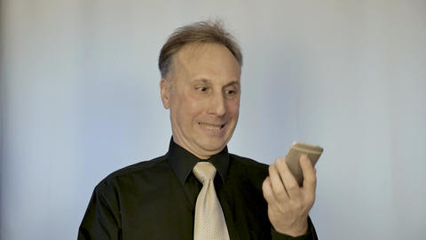 A man is very angry and breaks his phone. He has bad news and the phone does not Live Action