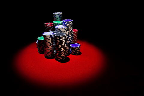 Poker chips stack on red table 002c Fotografía