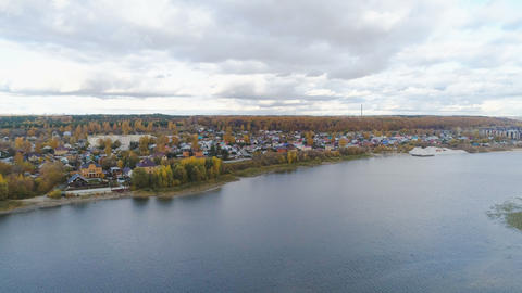 aerial view nice cottage town on large tranquil lake bank Live Action