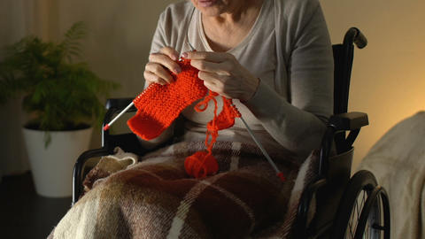 Disabled woman with poor sight trying to knit, annoyed and helpless in old age Footage