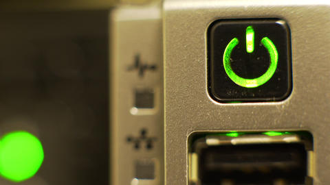 macro of a computer power button with flashing lights in the background 4k Footage