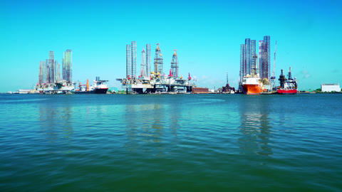 oil rigs and jack up barges in Galveston bay 4k Live Action