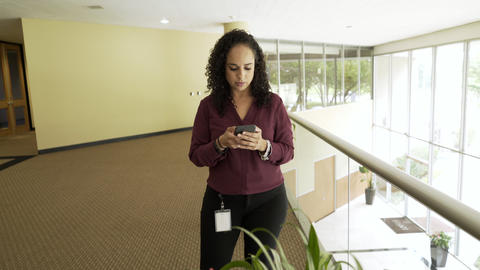 reveal businesswoman texting on her cell phone in the office and walks off 4k Footage