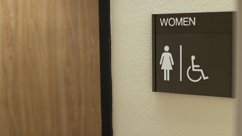 Woman Walking Into An Office Womans Restroom 4k stock footage