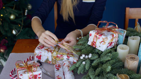 Female hands wrapping christmas presents Footage