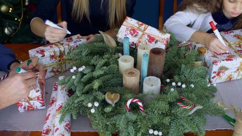 Human hands writing names on Christmas presents Footage