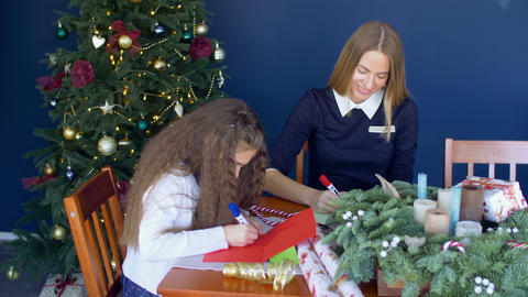Family writing traditional greeting cards for xmas Footage