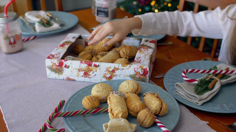 Child's hand reaching out to take christmas cookies Footage