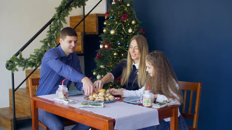 Family eating christmas cookies at festive table Footage