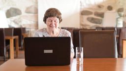 Happy Senior Woman Using Laptop At The Coffee Shop Footage