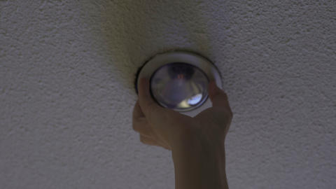 Electric service replacing wiring and installing modern energy saving light bulb Footage