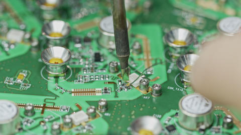 Close up of manual soldering of a large circuit board Live Action