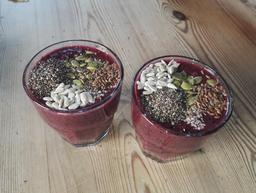 Two Glasses of Smoothie full of Seeds On a Table Photo