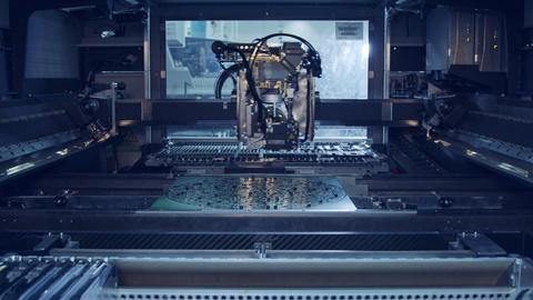 Advanced SMT Machine places components on a circuit board Live Action