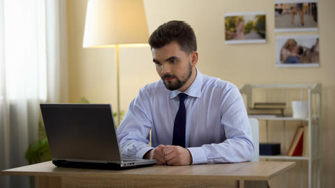 Happy man in business suit sighs with relief after successful interview online Live Action