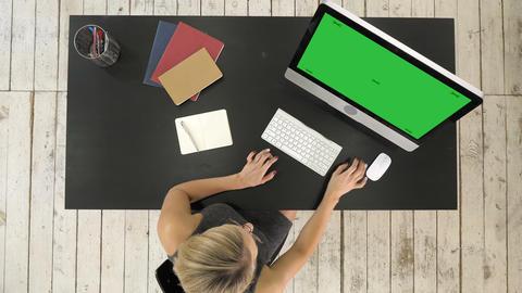 Girl watching on screen of computer. Green Screen Mock-up Display ビデオ