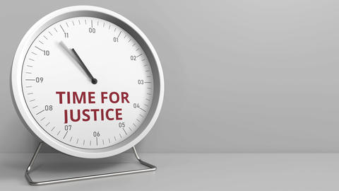 TIME FOR JUSTICE caption on the clock face. Conceptual animation ライブ動画