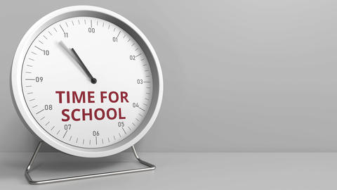 Clock with revealing TIME FOR SCHOOL caption. Conceptual animation Footage