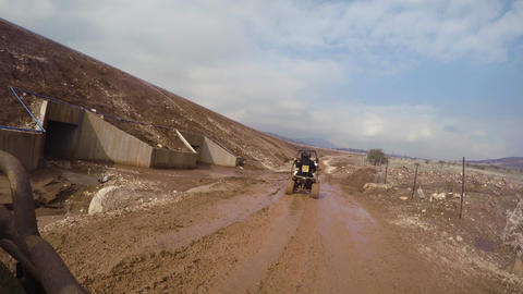 ATV ride on muddy dirt off road GIF