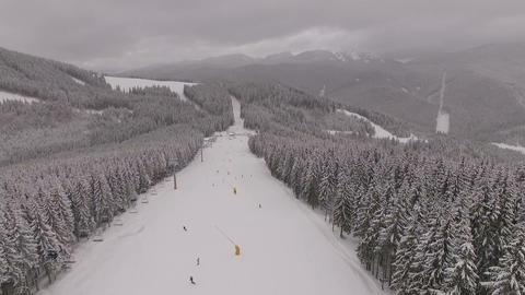 Aerial shot of ski resort during snowy weather GIF