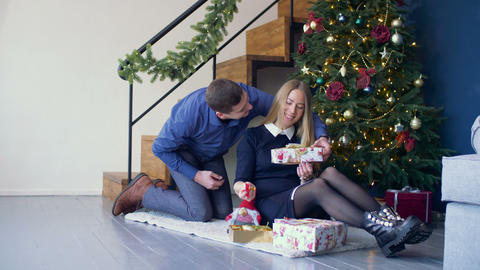 Loving man surprising his woman with christmas gift Footage