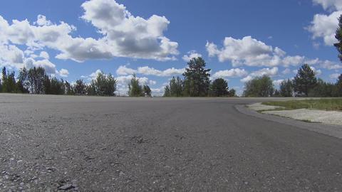 High speed car motion on asphalt road, motorsport competition, racetrack Live Action