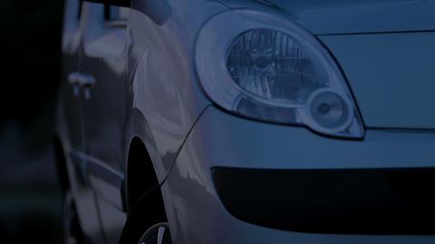 Headlamp turning on during car presentation, transport technology, parking Footage